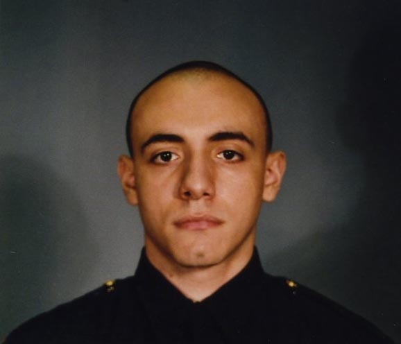 This photo provided by the Jersey City Mayor's office shows Officer Melvin Santiago.  Santiago was shot in the head while still in his police vehicle as he and his partner responded to an armed robbery call at a Walgreens Pharmacy at about 4.a.m., Jersey City Mayor Steven Fulop said in a statement. Fulop says Santiago was pronounced dead at Jersey City Medical Center. No other details about the officer were immediately released.  Fulop said officers responding to the robbery call shot and killed the man who shot Santiago. He was not immediately identified. (AP Photo/Jersey City Mayor's office)
