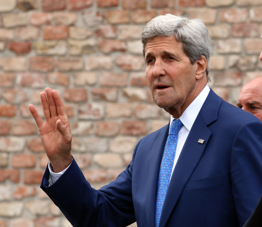 U.S. Secretary of State John Kerry was in discussions Monday with Iran's top diplomat to try to get faltering nuclear negotiations moving before Sunday's deadline for a comprehensive agreement.