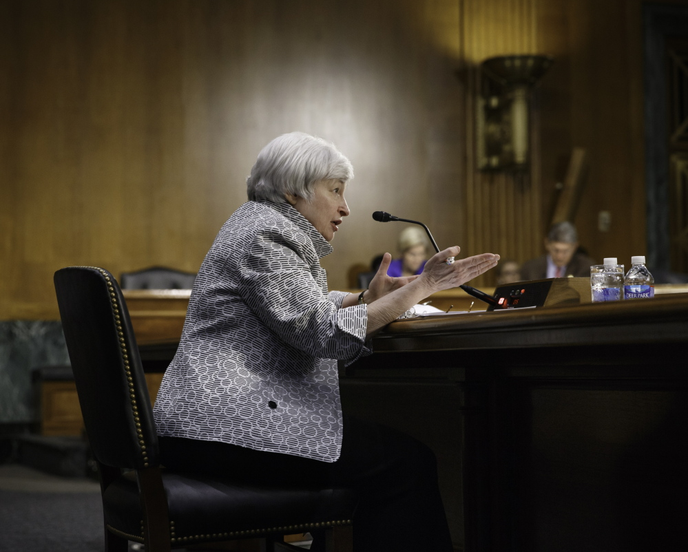 "Federal Reserve Chairwoman Janet Yellen testifies Tuesday before the Senate Banking Committee. ""Although the economy continues to improve, the recovery is not yet complete"" and monetary stimulus is still needed, Yellen said in her semi-annual testimony."
