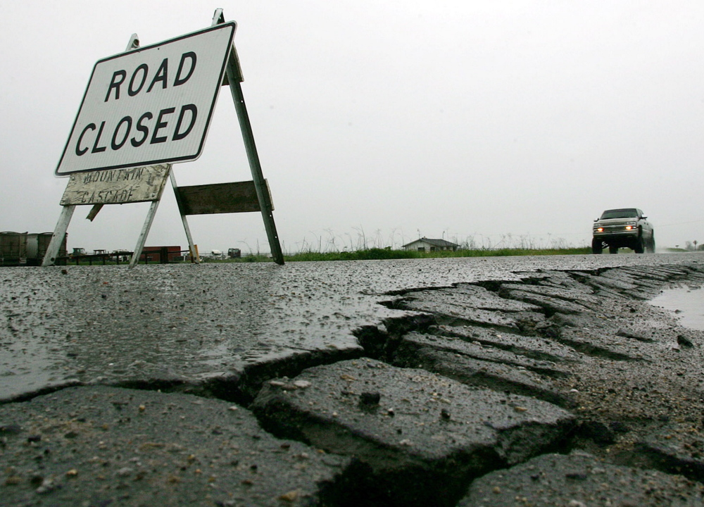 A sign warns that a damaged road is closed. The Highway Trust Fund has been on the edge of bankruptcy since 2008.