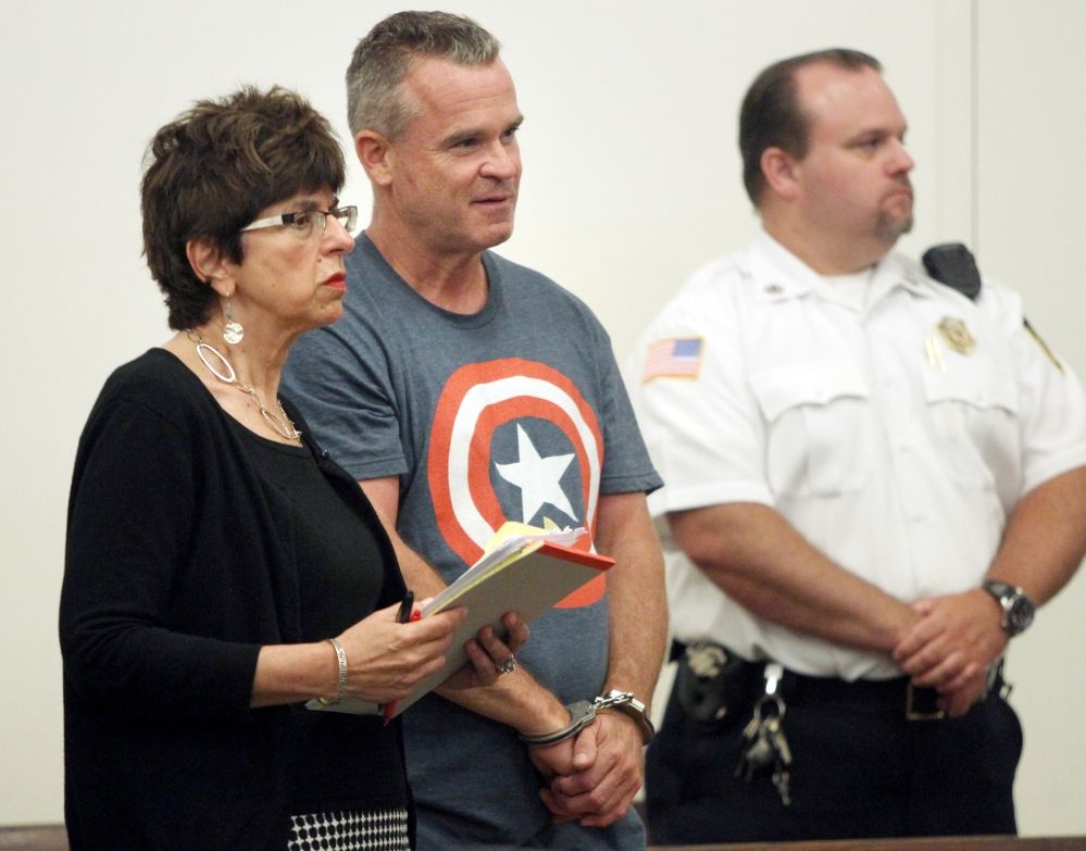The Associated Press James Lacroix, 53, center, appears with defense attorney Penelope Psomos at Barnstable District Court on Wednesday.