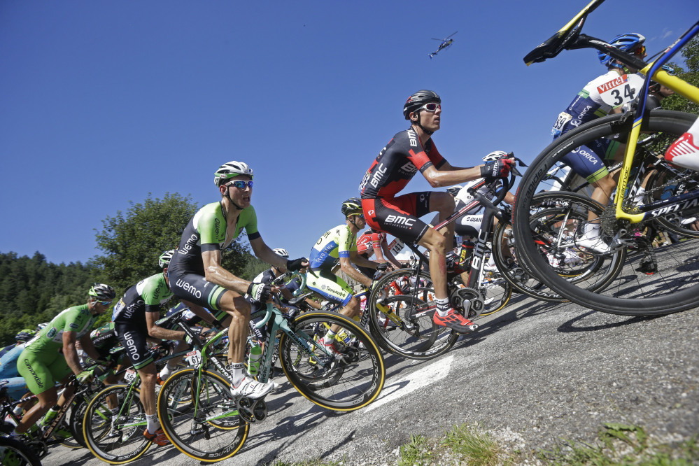 Tejay van Garderen of the U.S., center right ion black and red jersey, and Netherland's Bauke Mollema, center left in green and black jersey, climb during the eleventh stage of the Tour de France cycling race over 187.5 kilometers (116.5 miles) with start in Besancon and finish in Oyonnax, France, Wednesday.