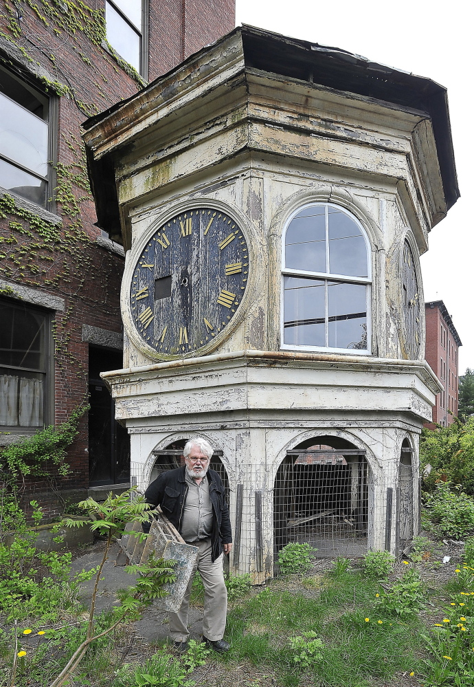 Historian George Collord leaves the Lincoln Mill clock tower on Lincoln Street in Biddeford with the ladder he uses to access the upper floor, in this May 2014 photo.