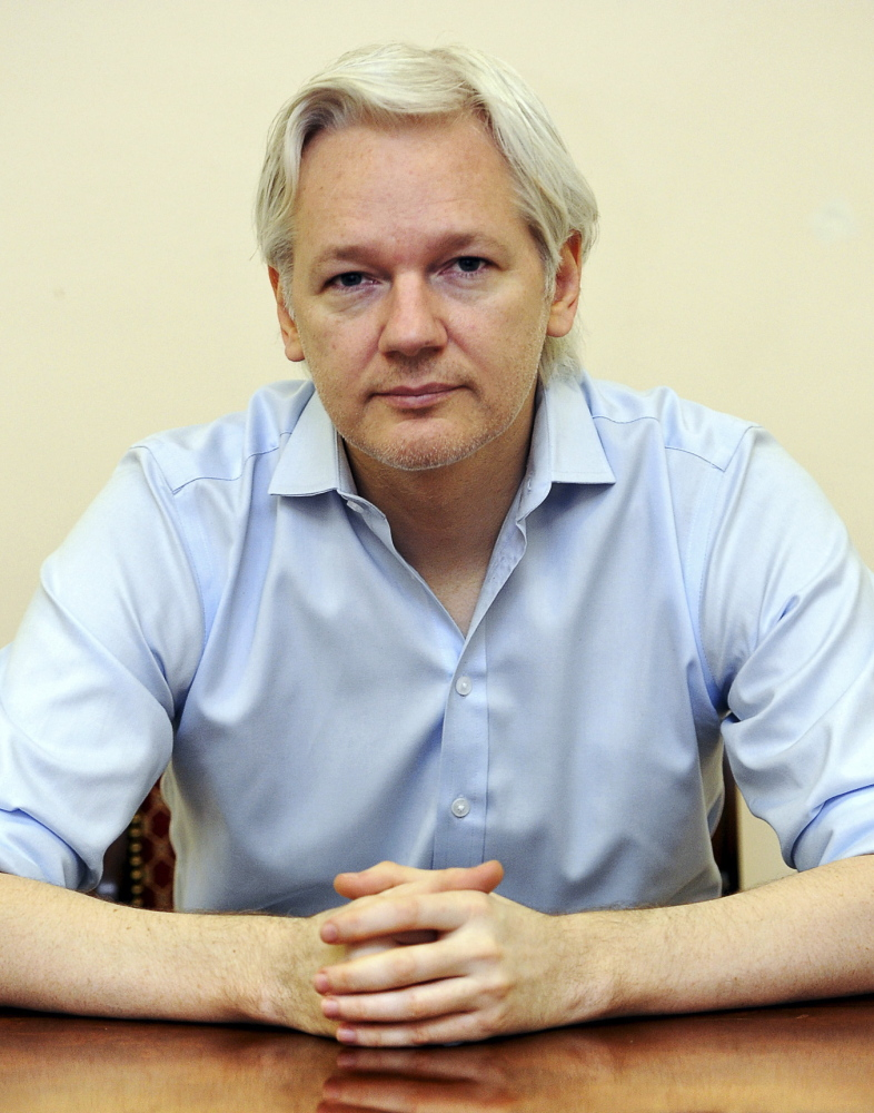WikiLeaks founder Julian Assange speaks to the media inside the Ecuadorean embassy in London in June.