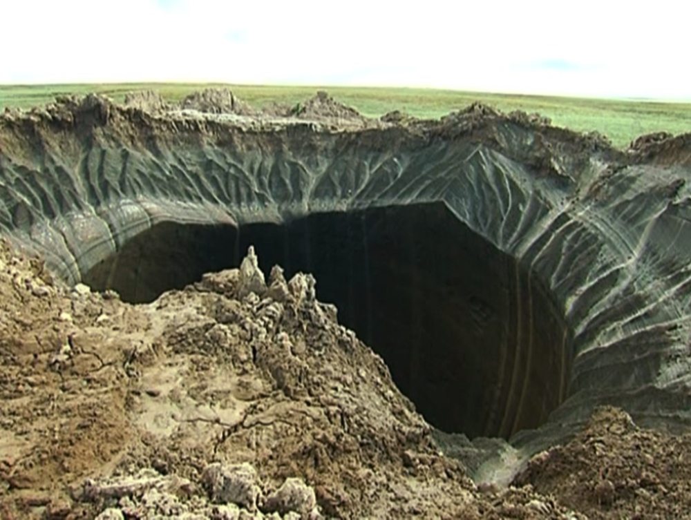 This frame grab made Wednesday, July 16, 2014, shows a crater, discovered recently in the Yamal Peninsula, in Yamalo-Nenets Autonomous Okrug, Russia.
