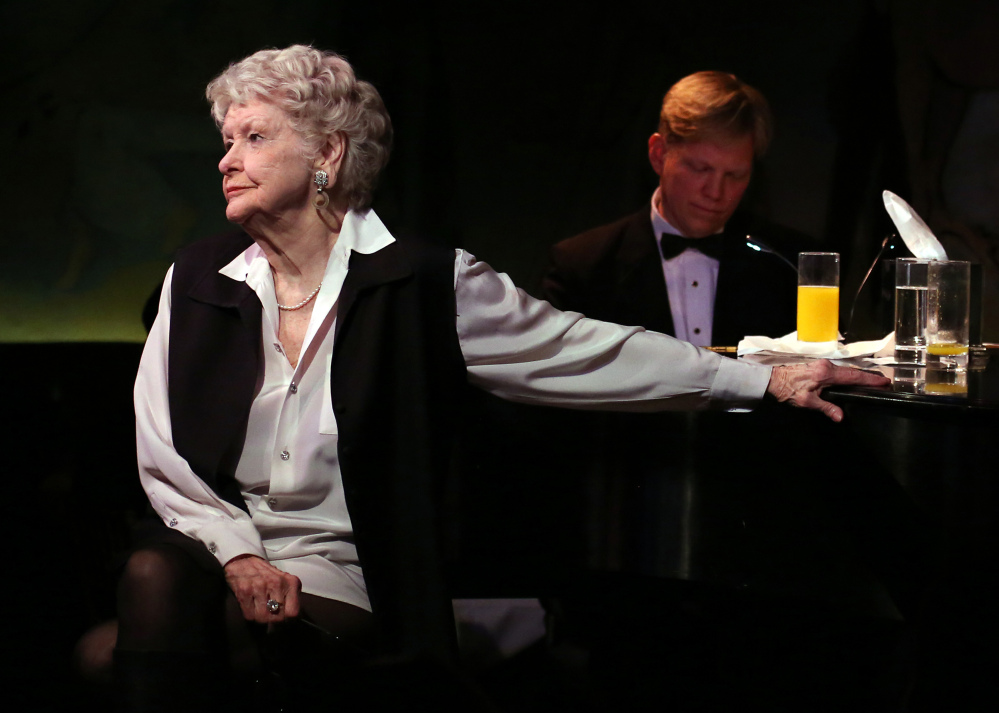 Elaine Stritch performs in her final engagement at the Cafe Carlyle in New York with Rob Bowman at the piano in this 2013 photo.