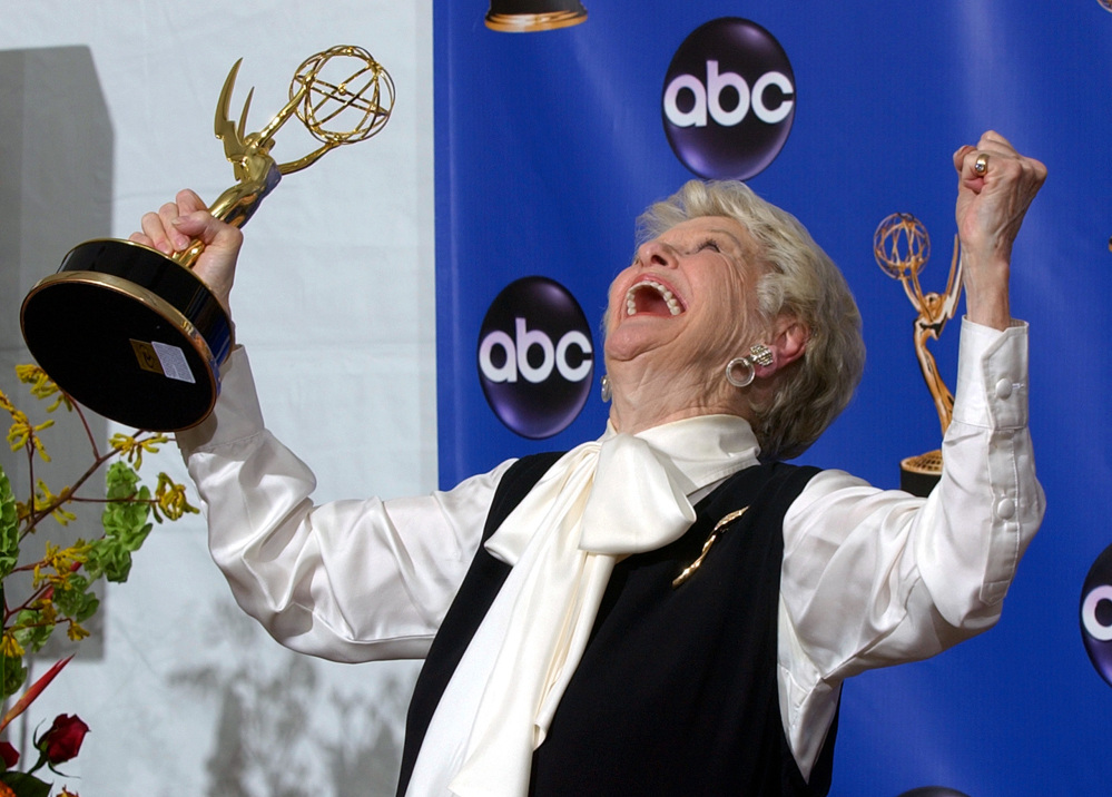 Elaine Stritch celebrates with her trophy for outstanding individual performance in a variety or music program at the 2004 Emmy Awards in Los Angeles.