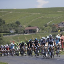 "China's Cheng Ji, front, nicknamed the ""breakaway killer,"" sets the pace as the pack chases him after a breakaway during the 12th stage of the Tour de France on Thursday in Saint-Etienne, France."