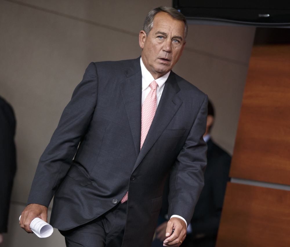 "Speaker of the House John Boehner, R-Ohio, arrives for a news conference on Capitol Hill on Thursday. He said, ""I don't have as much optimism as I'd like to have"" about Congress solving the U.S. border crisis."