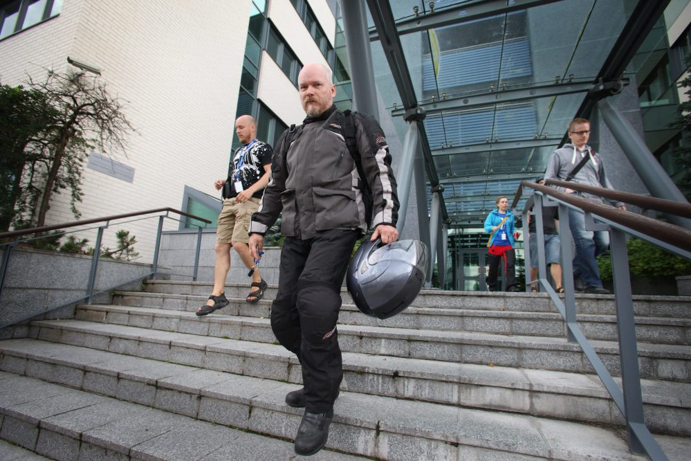 Workers leave Microsoft's office in Oulu, Finland, on Thursday. Microsoft announced the biggest layoffs in its history Thursday, saying it will cut up to 18,000 jobs.