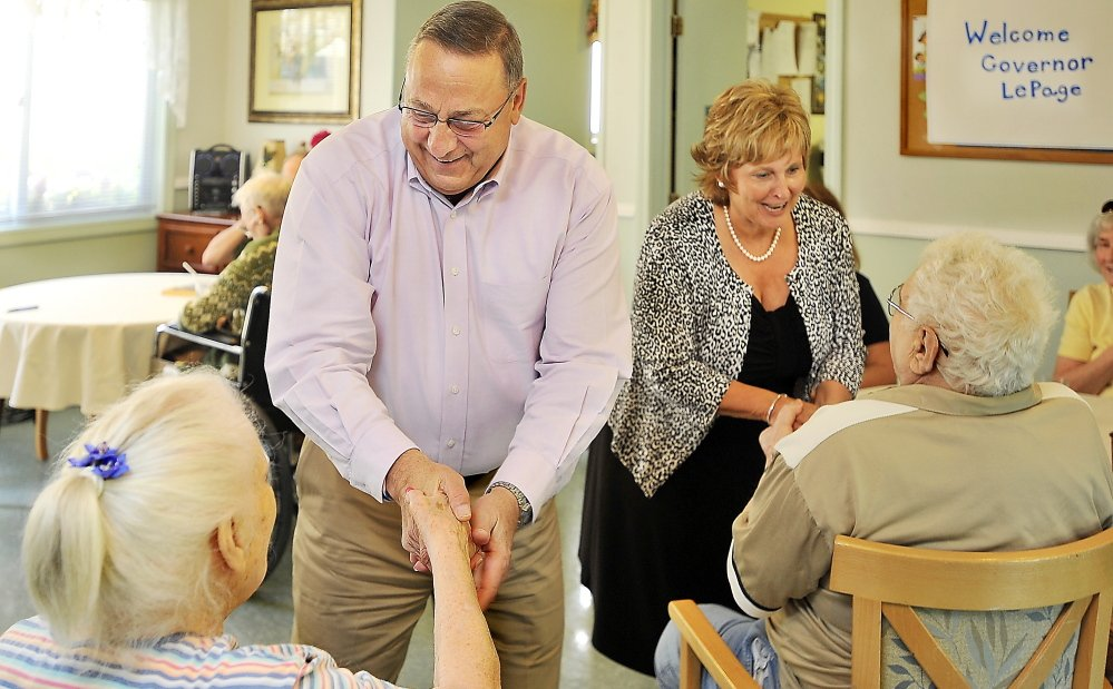 Gov. Paul LePage and first lady Ann LePage visit a nursing home in Yarmouth on July 11. The governor said Thursday that surplus from the state's Medicaid program will provide $13.1 million for Maine's 106 nursing homes.