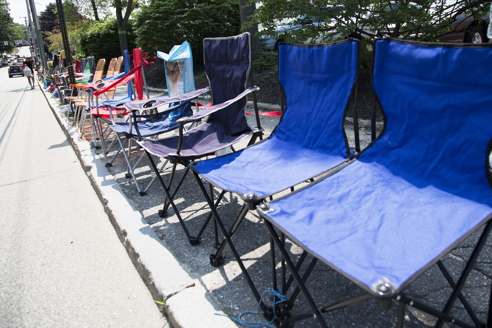 A row of chairs lines Main Street, saving spots for spectators of the Yarmouth Clam Festival parade on Friday.