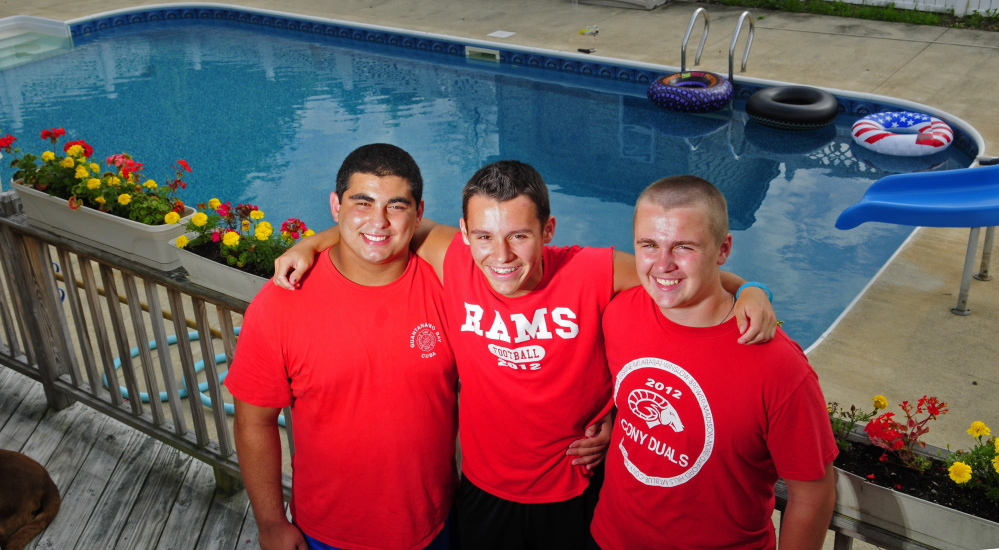 Kyle Armstrong, center, was rescued by friends Elias Younes, left, and Devon O'Connor when he had a seizure in this pool at O'Connor's Augusta home.