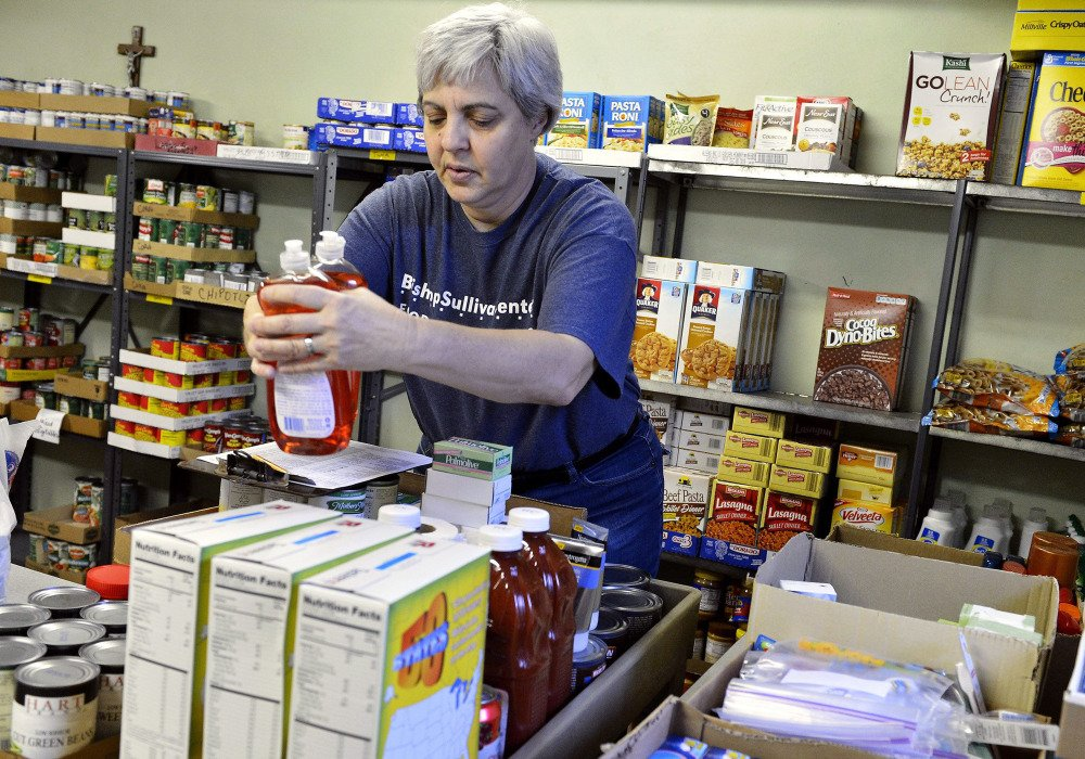Colleen Simon, seen in April working as the food pantry coordinator for the Diocese of Kansas City-St. Joseph in Kansas City, Mo., was later fired over her same-sex marriage.