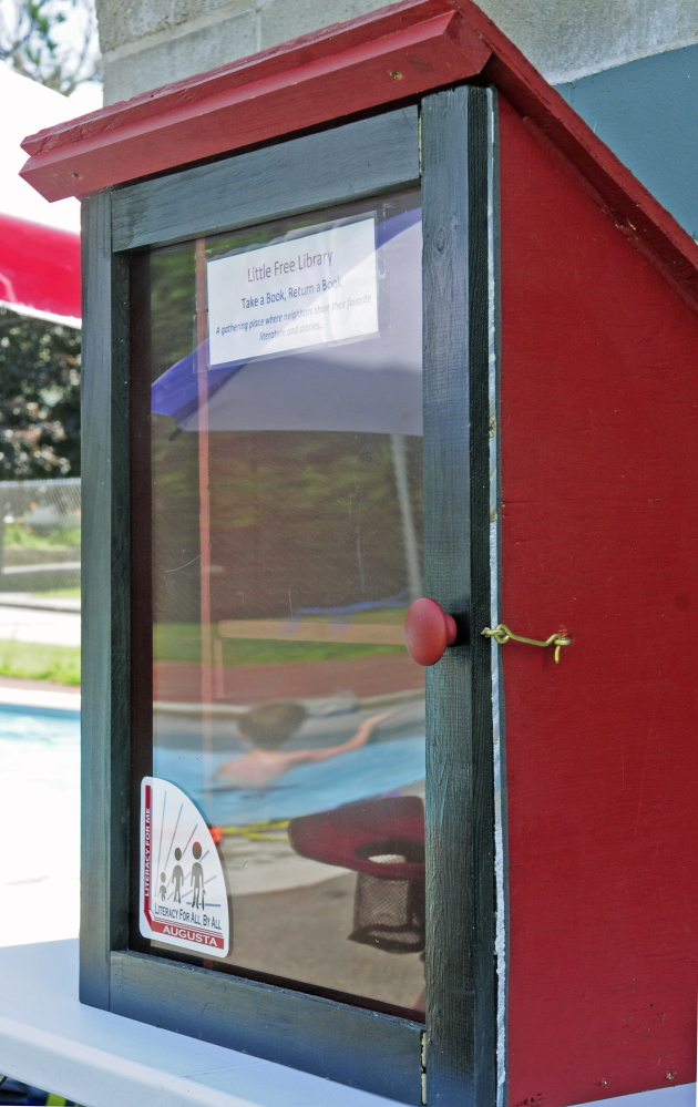 The Little Free Library at the Williams Playground pool in Augusta is one of four small book repositories created to encourage reading by youngsters.