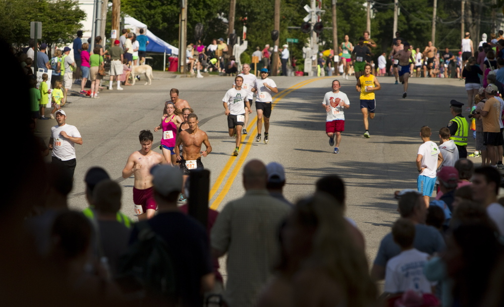 Runners head for the finish line in the 2014 Yarmouth Clam Festival 5 Mile run on Saturday.
