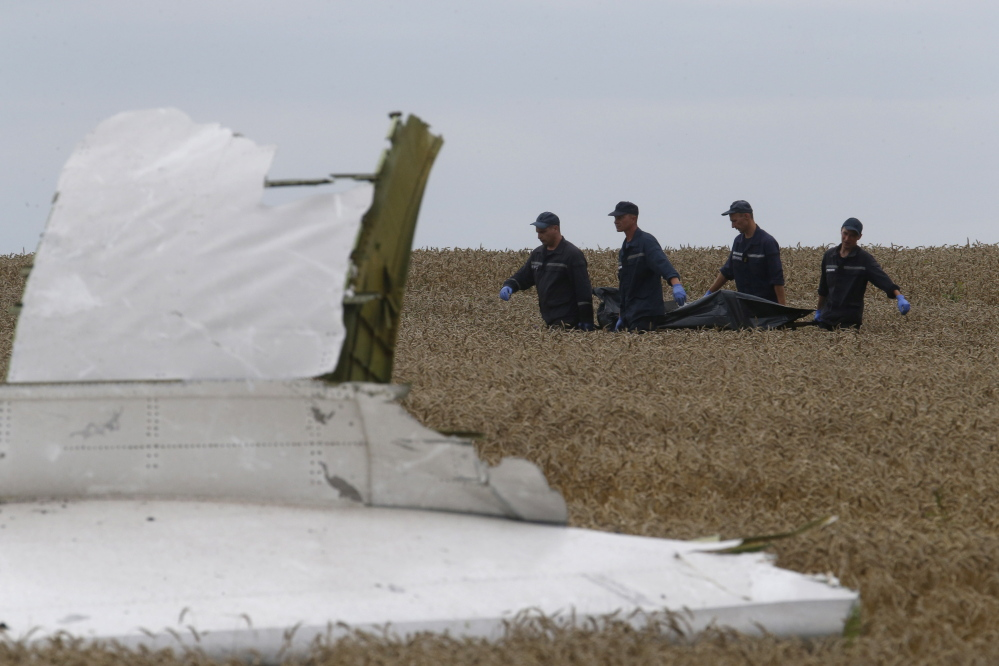 Members of the Ukrainian Emergency Ministry carry a body at the crash site of Malaysia Airlines Flight MH17, near Grabovo in the Donetsk region of Ukraine on Saturday.