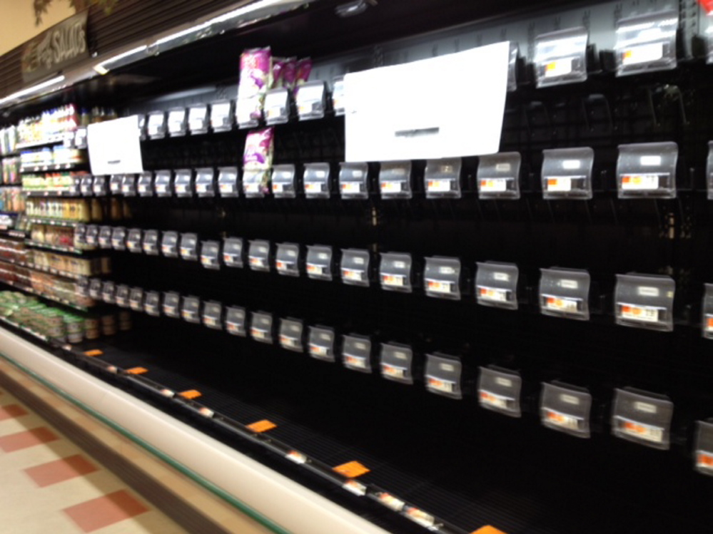 Market Basket shelves normally stocked with prepared salads are empty Saturday at the store in Biddeford amid a corporate leadership squabble.