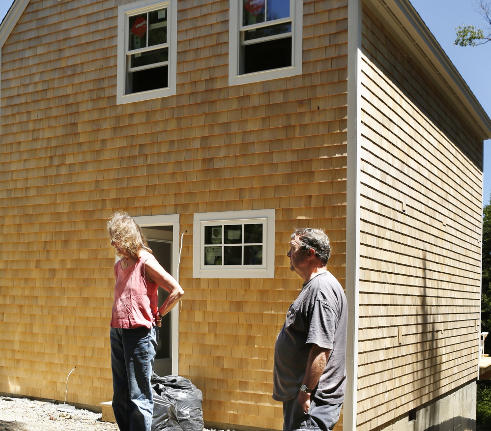 "Sally and David Wylie of Vinalhaven are building an addition to their home with sound-deadening walls to escape the ""whomp, whomp, whomp"" generated by turbines at the Fox Islands Wind Project."