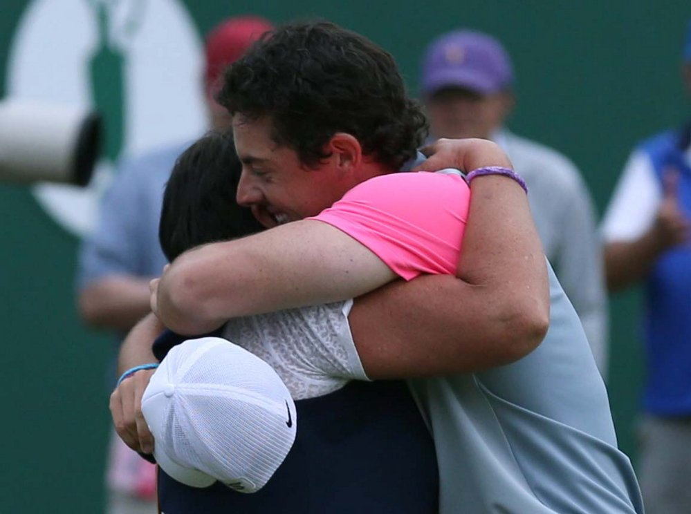 Rory McIlroy celebrates winning the British Open Golf championship with his mother, Rosie, after the final round at the Royal Liverpool golf club in Hoylake, England, on Sunday.