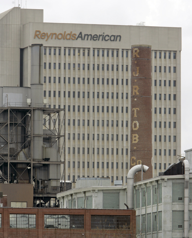 A smokestack of an old R.J. Reynolds Tobacco plant frames the Reynolds American building in Winston-Salem, N.C., in 2008. A Florida jury has slammed R.J. Reynolds Tobacco Co. with $23.6 billion in punitive damages in a lawsuit filed by Cynthia Robinson, the widow of a longtime smoker who died of lung cancer in 1996.