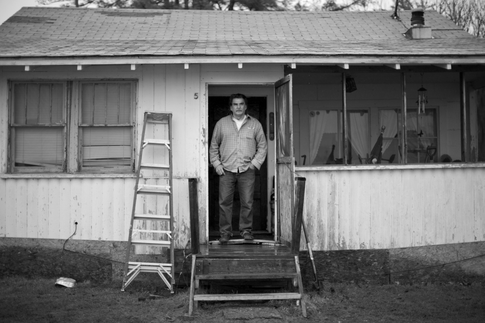 Former tribal Chief Robert Newell stands in the doorway of the seasonal camp he now calls home at Indian Township. Newell spend nearly four years in a Pennsylvania prison after being convicted late in 2008 on 29 counts that included conspiring to defraud the United States, misapplication of federal funds, fraud and lying to federal agencies.