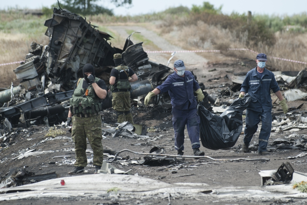 Plane Crash Photos Bodies With a victim's body in a