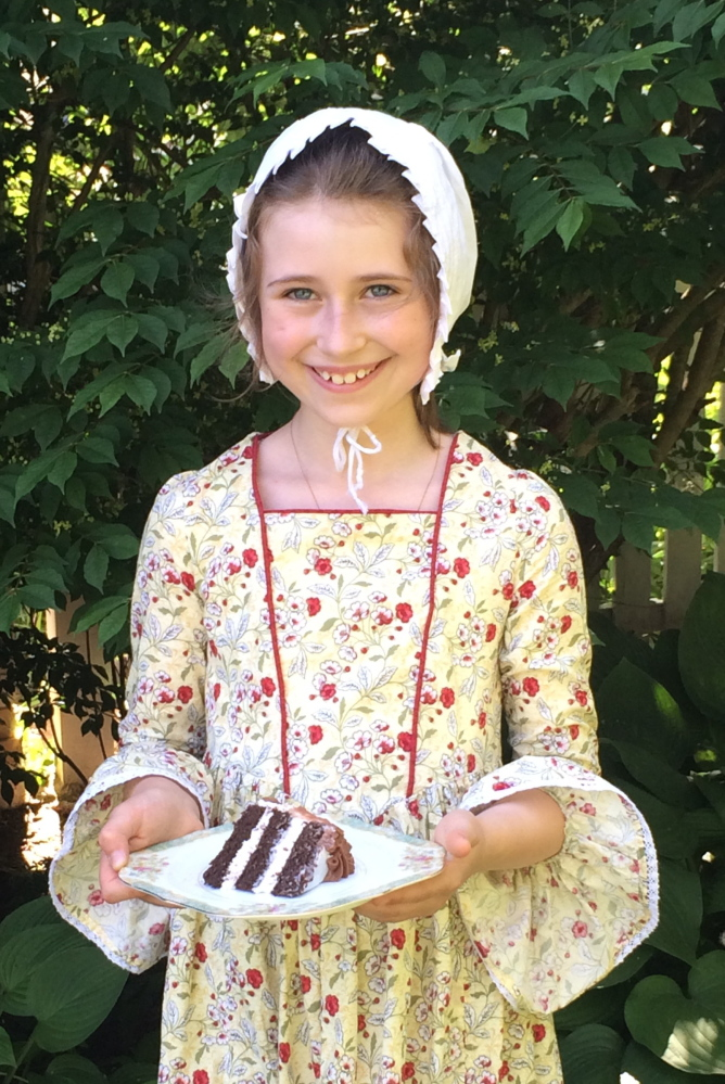 """Junior docent Elizabeth Akin dresses in period costume and serves cake for an event at the Gen. Henry Knox Museum in Thomaston. The museum invites the public to attend its annual """"Cut the Cake!"""" event Saturday, celebrating the birthday of namesake Henry Knox."""