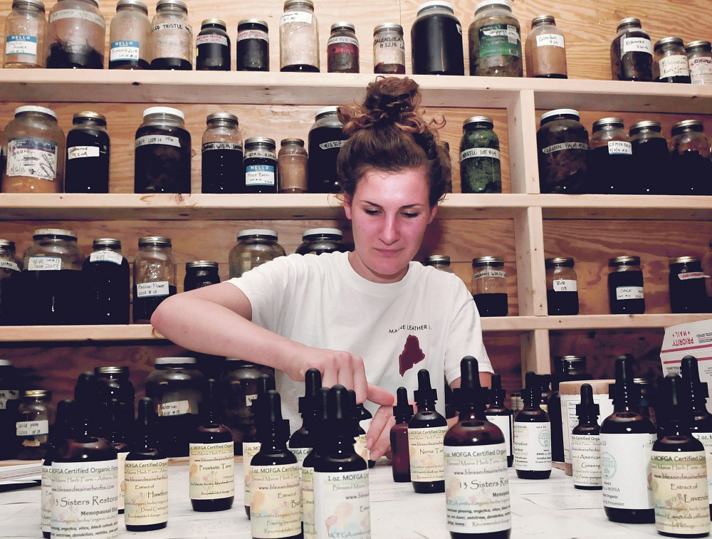 Belle Hilmer creates tinctures made with ingredients grown at Blessed Maine Herb Farm in Athens. She is a daughter of the farm's founder, Gail Faith Edwards.