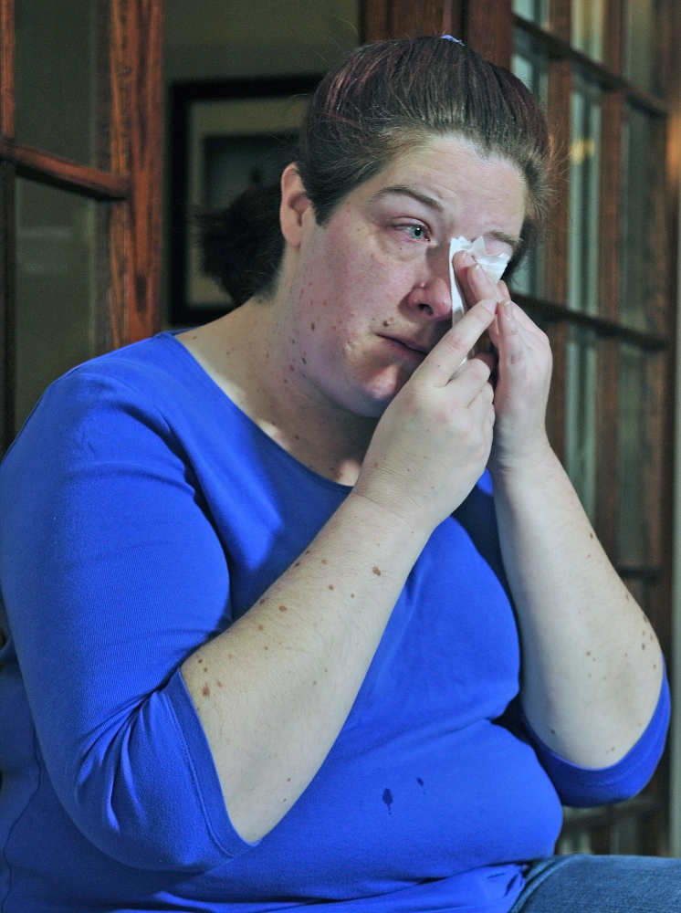 Jennifer Neumeyer wipes her eyes last May in her Augusta home. An attorney who had been helping Neumeyer to appeal her case has moved out of state.