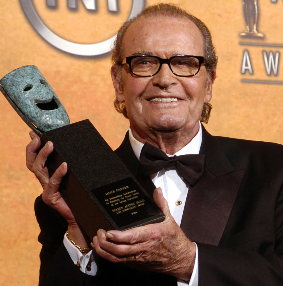 James Garner holds his life achievement award from the Screen Actors Guild in 2005.