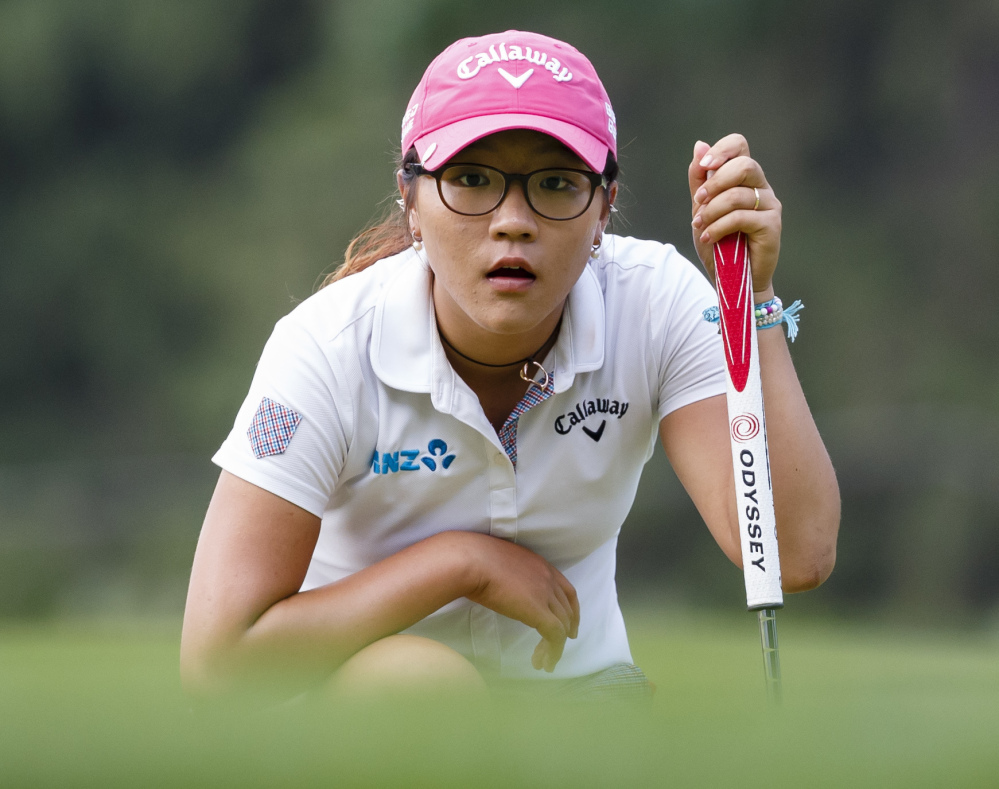 Lydia Ko reads a putt on the 17th hole during the final round of the Marathon Classic on Sunday in Sylvania, Ohio. Ko birdied on the final hole to edge So Yeon Ryu, 269-270.