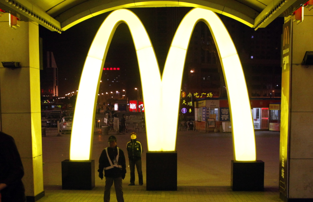 A McDonald's logo is displayed at a train station in China, where a series of scandals may hurt the fast-food business.