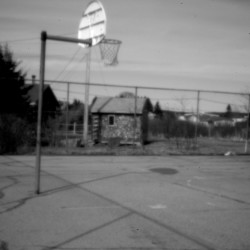 "A run-down basketball court at Pleasant Point. Decades after the land claims pact,, Maine's Passamaquoddy reservations have become uneasy places to thrive. Ira Gilbert, an unemployed tribal member at Indian Township, puts it succinctly: ""There's a big law problem here: There is none."""