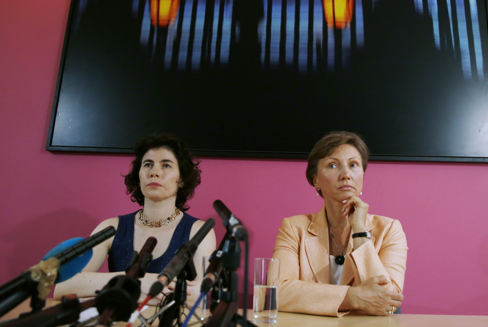 Alexander Litvinenko's widow, Marina Litvinenko, right, speaks in London in favor of a reopened injury into her husband's death in 2006. With her is her lawyer Elena Tsirlina.