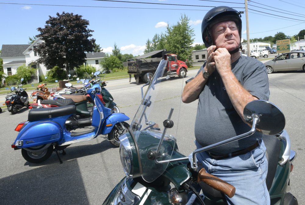 Clayton Farrar, 82, of South Portland says he loves to ride his scooter and visits Cumberland County Scooters shop in Portland several times a week. John Patriquin/Staff Photographer