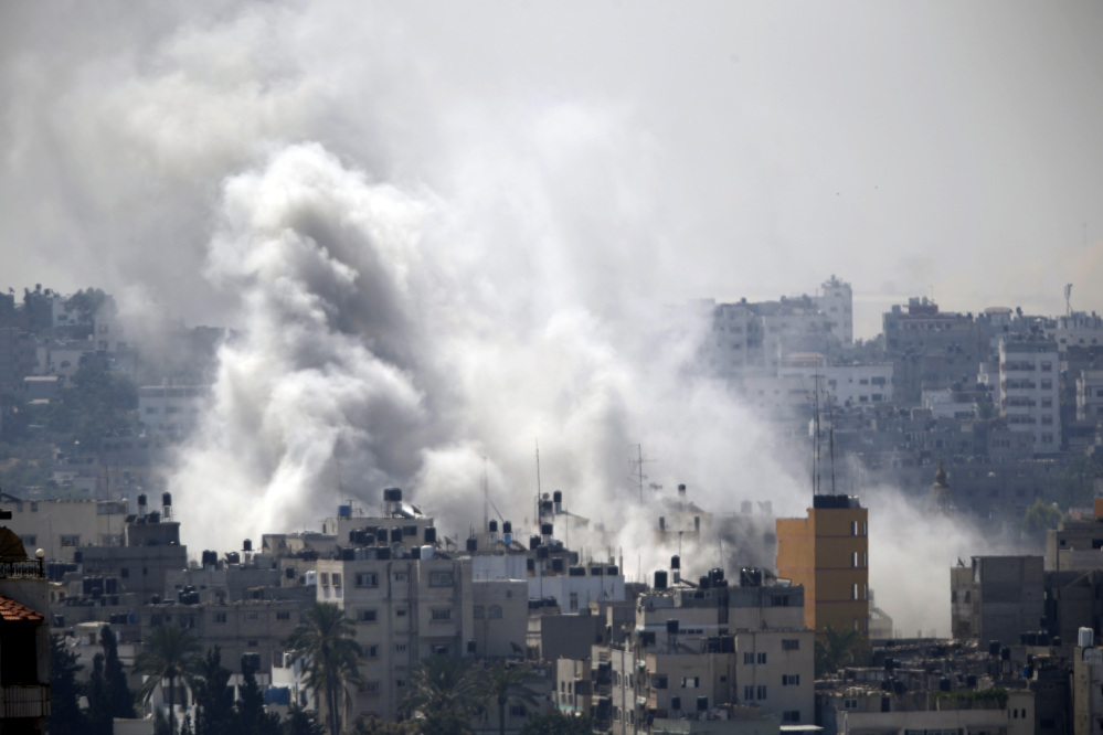 Smoke from an Israeli air strike rises over Gaza City on Wednesday.