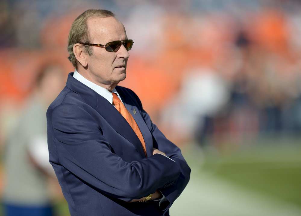 In this Dec. 2, 2012 file photo, Denver Broncos owner Pat Bowlen watches as the Broncos warm up before an NFL football game against the Tampa Bay Buccaneers in Denver.