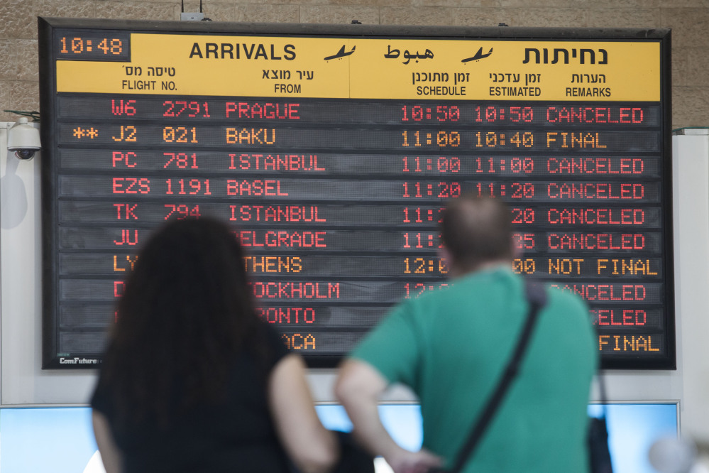 A arrivals flight board displays various canceled and delayed flights in Ben Gurion International airport a day after the U.S. Federal Aviation Administration imposed a 24-hour restriction on flights after a Hamas rocket landed Tuesday within a mile of the airport, in Tel Aviv, Israel.
