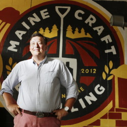 "Luke Davidson, a Maine native, owns Maine Craft Distilling in Portland. ""We call ourselves farm to flask, so we're trying to focus as much of the region as we can in the bottle,"" he said."