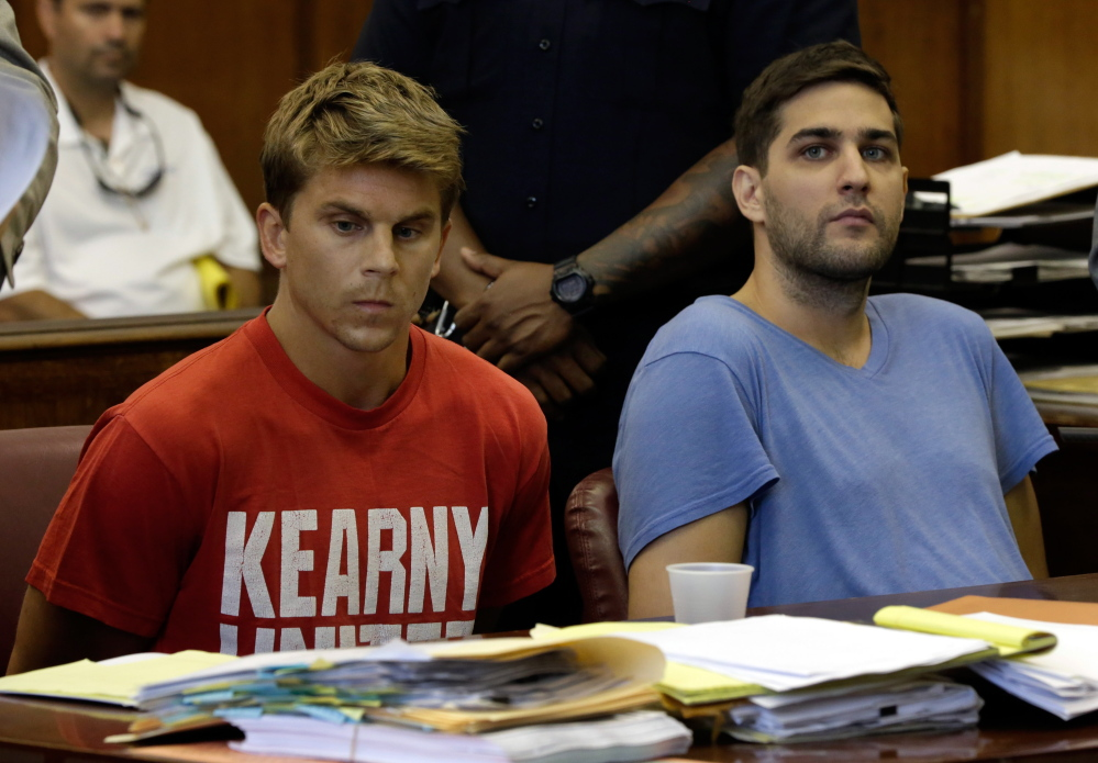 Bryan Caputo, left, and Daniel Petryszyn sit during arraignment proceedings in New York state Supreme Court. They are two of six people who were indicted Wednesday in an international ring that took over more than 1,600 StubHub users' accounts and fraudulently bought tickets.