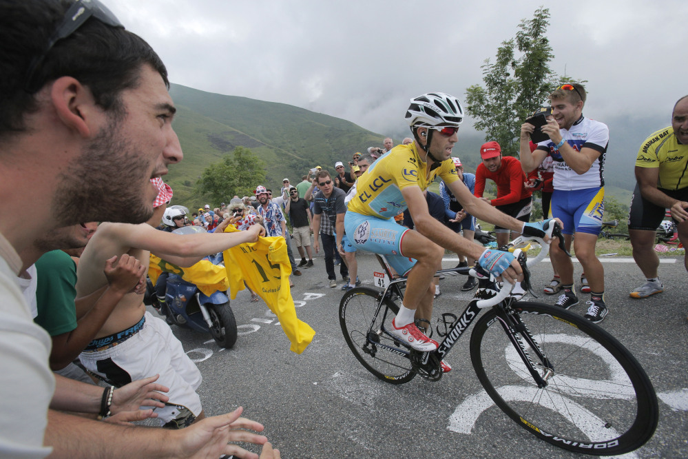 Stage winner Vincenzo Nibali of Italy climbs towards Hautacam after breaking away from his rivals during the eighteenth stage of the Tour de France cycling race over 145.5 kilometers (90.4 miles) with start in Pau and finish in Hautacam, Pyrenees region, France.