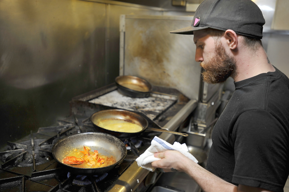 Jonathan Greydanus sautees lobster claws next to freshly made lobster bisque as he makes Lobster, Corn and Poblano Bisque at Zapoteca. Gordon Chibroski/Staff Photographer