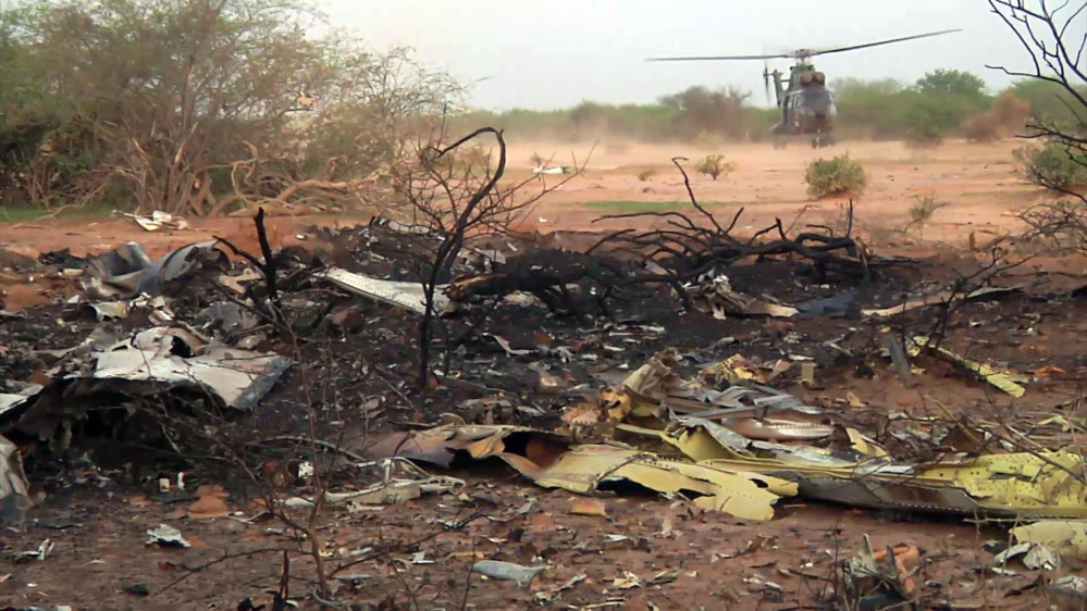 A helicopter lands at the site of the Air Algerie plane crash in Mali on Friday in this photo provided by the French army.
