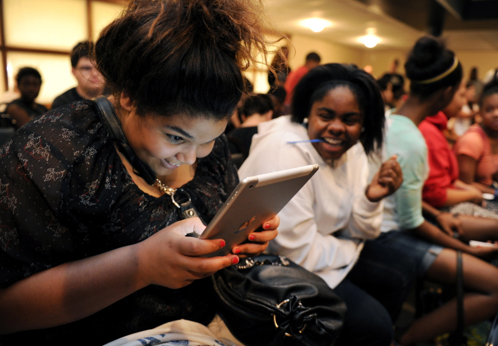 Michaela Kerley tries out one of 10 iPads given to the Boys & Girls Clubs of the Tennessee Valley by U.S. Cellular this month.