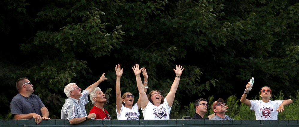 Saco Little League fans celebrate a home run by their team Friday.  Gabe Souza/Staff Photographer