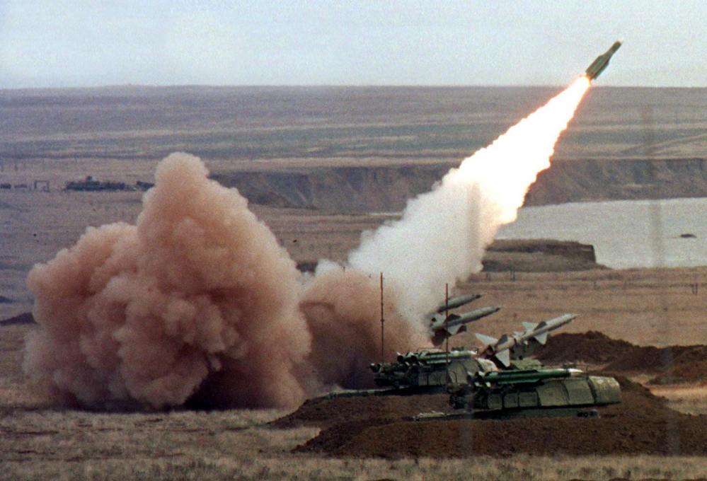 A Buk launcher is shown in action during Ukrainian army maneuvers in the Crimean peninsula Oct. 12. A Buk launcher is thought to have been used to down Malaysian Airlines Flight 17.
