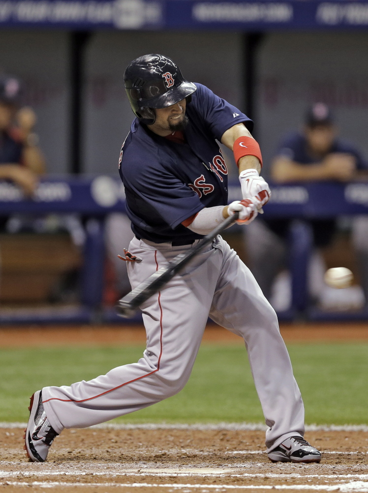 Boston's Shane Victorino connects for an RBI single off Tampa Bay Rays starting pitcher David Price in the sixth inning Friday in St. Petersburg, Fla. David Ortiz scored on the hit.