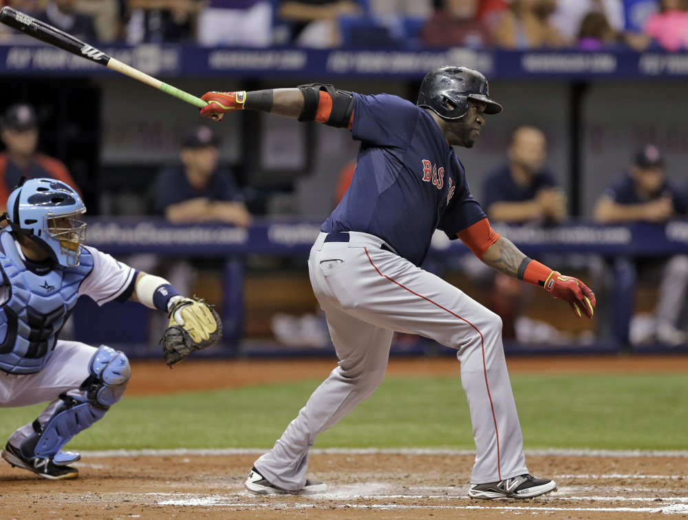 Red Sox designated hitter David Ortiz hits an RBI single off Rays starting pitcher David Price in the sixth inning Friday in St. Petersburg, Fla. Rays catcher Jose Molina, left, looks on. Dustin Pedroia scored on the hit.