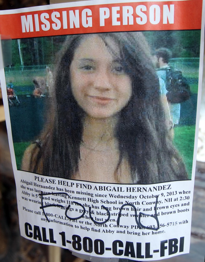 In this file photo taken Tuesday July 22, a missing person poster of Abigail Hernandez displayed in a storefront window in North Conway, N.H., shows Hernandez has been found.